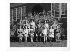 "Lovettsville teachers, circa 1950. Seated, from left: Jean McKimmey Hawthorne, Dawn McKimmey Stine, Connie Magnus McKimmey, Lloyd A. Womeldorf, Anne Manning Beavers, Anna Lee Free Brumback, ""Miss Dot"" Potterfield; standing from left: Thomas Kane, ""Miss Winnie"" Myers, Kathleen Souder Taylor, Dorothy Souder Beatty, Elizabeth Frye, and Margaret Spring."