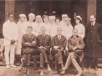 "The ""influenza staff"" at the B&O Hospital next to the YMCA in Brunswick in 1918.  Dr. Levin West and Dr. Harry Slicer Hedges are seated to the left, respectively, on the front row. Lena Sigafoose Troxell is standing with the black band on her hat to the right.  (Courtesy Brunswick History Commission)"