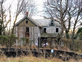 The Reed Farmhouse as it appears today. After years of deterioration and vandalism, the County is preparing to demolish it. Asbestos siding has been removed in preparation for demolition work.