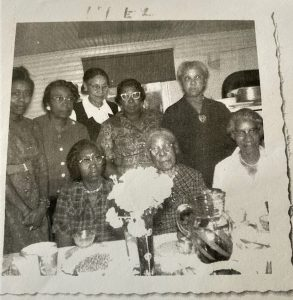 Emma Moten and friends around 1966. Back row left to right: Mae Long, Hannah Daniels, Jannett Smith, Patience Corbin, and Emma Moten. Front row left to right: Ethel Curtis, Jesse Lucas, and Myrtle Moten. (Hannah Daniels was a school teacher at Hillsboro school; Mae Long is the daughter of Ethel Curtis; Myrtle Moten married Emma Moten's brother Richard.) Photo courtesy Howard Timbers.