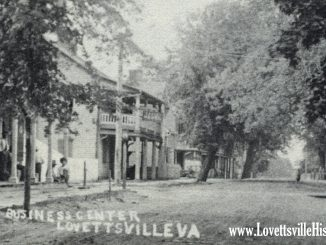 The building at center with the balcony was the old Lovettsville hotel and tavern which was probably built shortly after the town was laid out in 1820.  Among others, the building was acquired by Daniel Everhart in 1832, by John Snoots in 1847,  and by Jacob Snoots in 1856, according to Loudoun County land records.